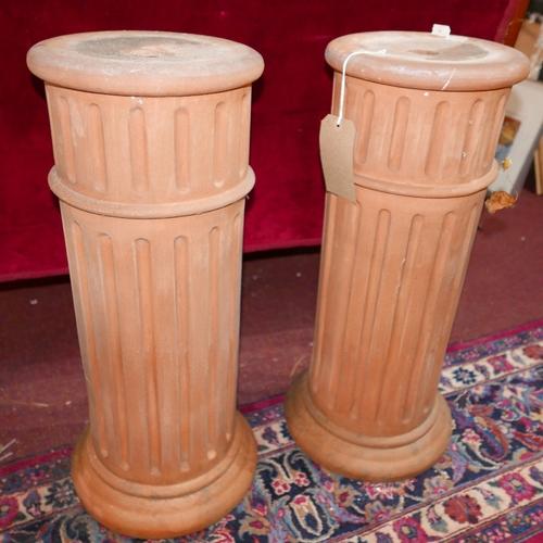 197 - A pair of terracotta columns, H.70cm (2)...