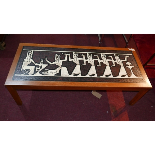 257 - A mid 20th century teak coffee table, inset with tiles depicting an Egyptian scene, H.40 W.130 D.54c...