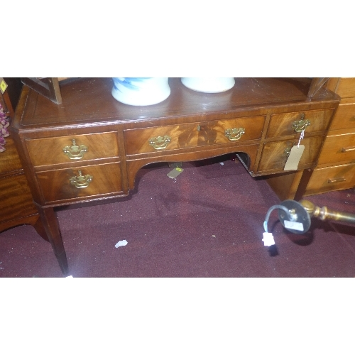 333 - A Georgian style mahogany desk, with leather top, five drawers, raised on tapered legs, H.76 W.106 D...