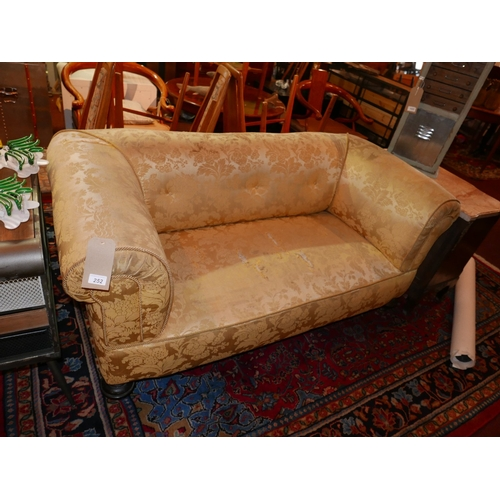 252 - An early 20th century Chesterfield sofa with floral damask upholstery, raised on turned legs and cas...