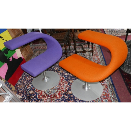 146 - A pair of Swedish Bla Station 'C' swivel chairs, stamped to base, upholstered in purple and orange f...