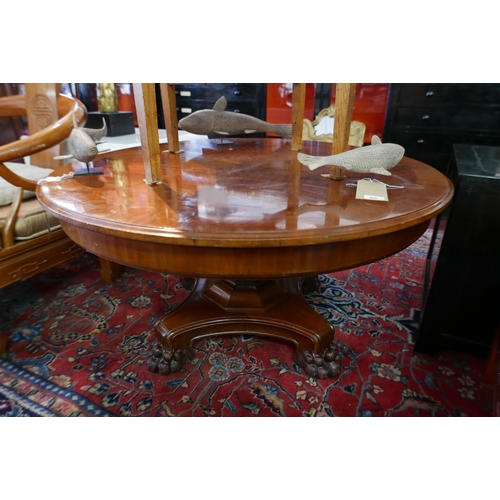 189 - A Georgian style mahogany and marquetry inlaid circular low table, raised on a quadraform base with ...