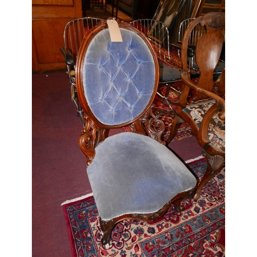 185 - A Victorian walnut nursing chair, with deep buttoned blue velour upholstery and carved frame, H.100c...