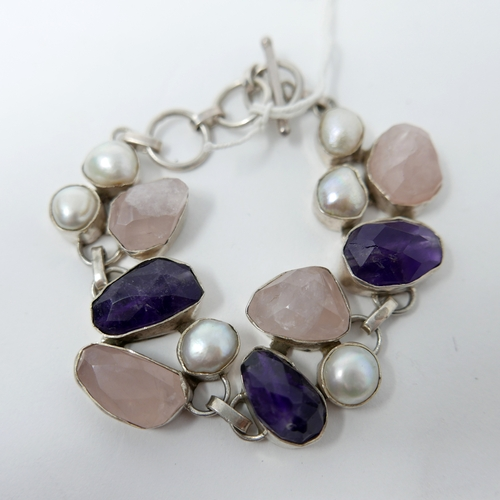 22 - A chunky sterling silver bracelet set with faceted rose quartz and amethyst with six large freshwate...