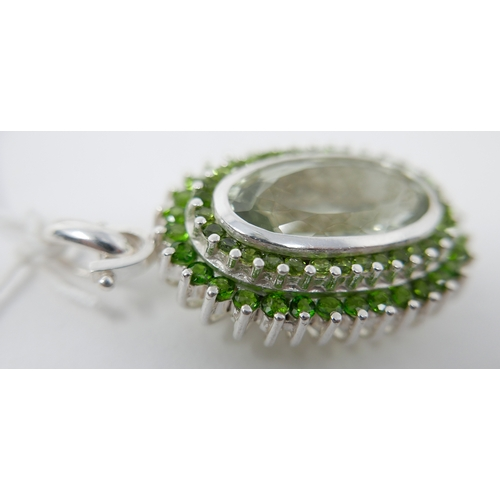 30 - A large sterling silver oval-shaped, green amethyst and green diopside studded pendant with sterling...