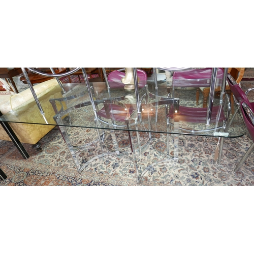 121 - A 20th century Merrow Associates dining table, with glass top raised on chrome base, H.73 W.91 D.198...