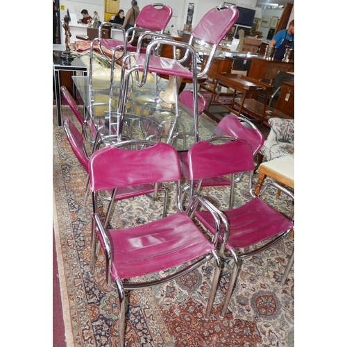124 - A set of eight 20th century tubular chrome dining chairs, with burgundy leather seat and back rests...