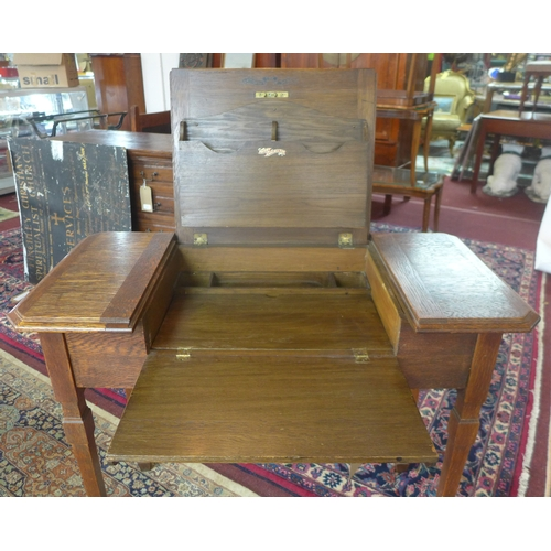 130 - An Edwardian Arts and Crafts oak metamorphic writing desk 'The Britisher Patent Writing Table', rais...