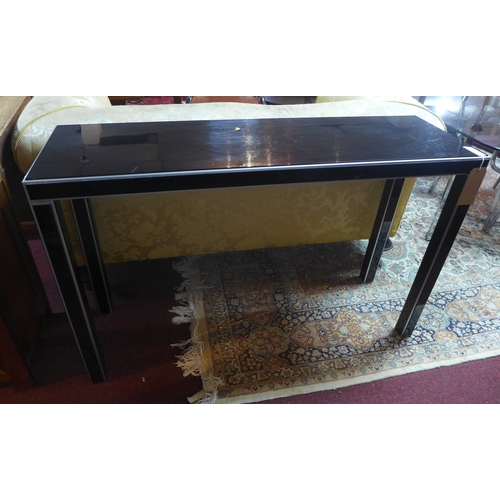 132 - A brushed steel and black perspex console table, H.77 W.122 D.39cm...