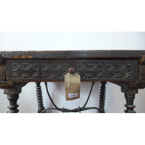 134 - An 18th century Spanish walnut side table, with single drawer, raised on turned bobbin legs joined b...