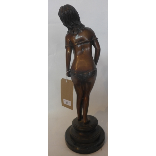 83 - A bronze statue of a semi nude female, raised on marble base, H.54cm...