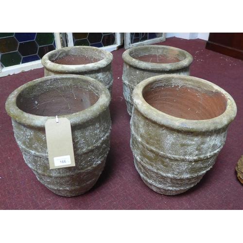 166 - Four small terracotta planters in the Atlantis style finish, H.37cm Diameter 31cm (4)...