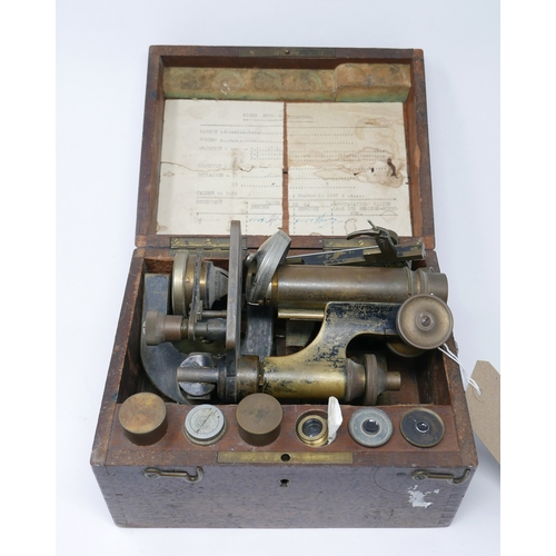 173 - An oak cased late 19th century French brass microscope by Stiassnie, Paris, complete with various le...