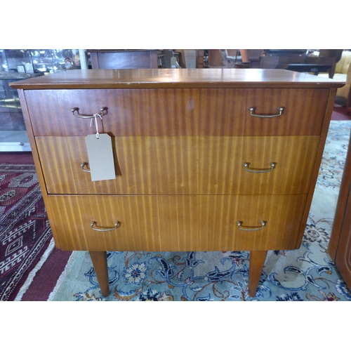 175 - A mid 20th century teak side chest, with three drawers, raised on tapered legs, H.73 W.77 D.43cm...