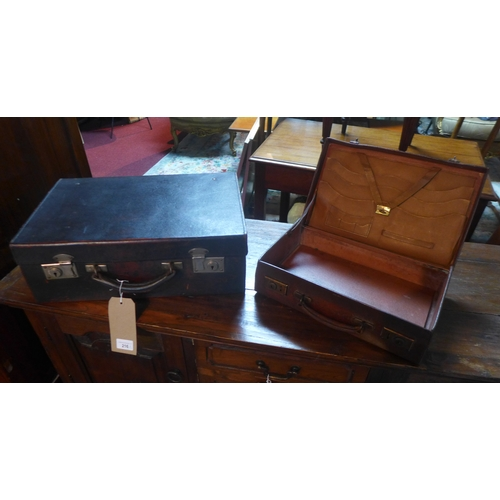216 - Two vintage leather cases, largest H.35 W.41 D.15cm (2)...