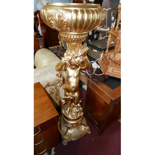 224 - A 20th century Rococo style gilt composite jardiniere stand in the form of a putti, H.137cm...