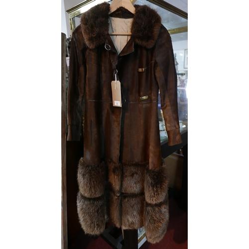 23 - A vintage ladies Furs Renee brown hide and fur coat...