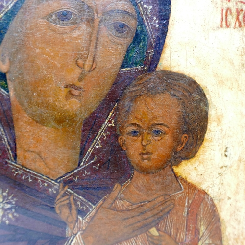 4 - An 18th century Russian icon depicting the Mother of God and Christ, tempera on wood panel with velv...