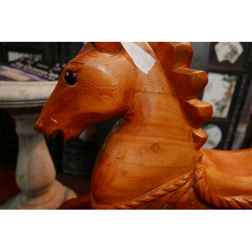 9 - A vintage hand-carved pine rocking horse with natural horse-hair tail, 90 x 137cm...