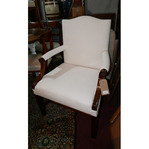 263 - A Georgian design mahogany Gainsborough style open armchair, with white linen upholstery raised on s...