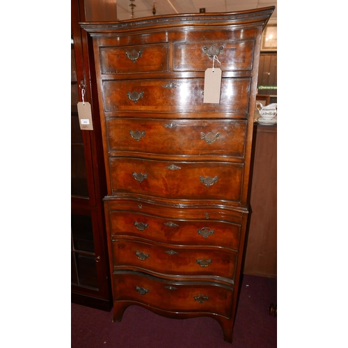 295 - An early 20th century mahogany serpentine chest on chest, with two short over six drawers, raised on...