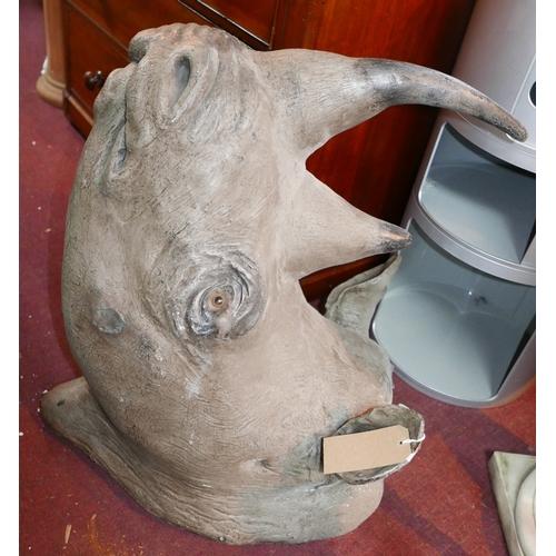 355 - A large 20th century fibreglass model of a rinho head...