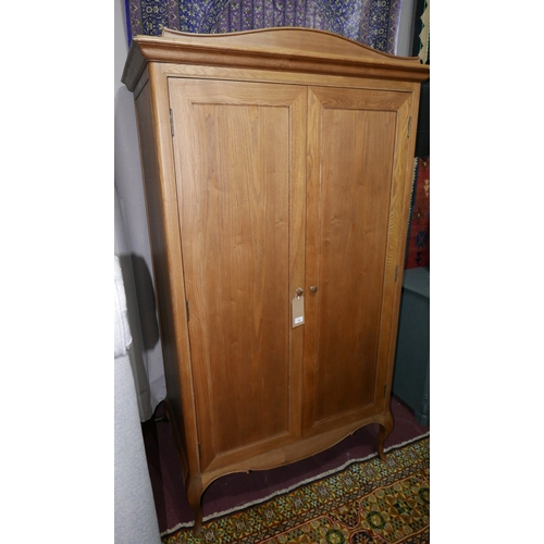 380 - A contemporary French oak armoire raised on cabriole legs, H.193 W.104 D.64cm...