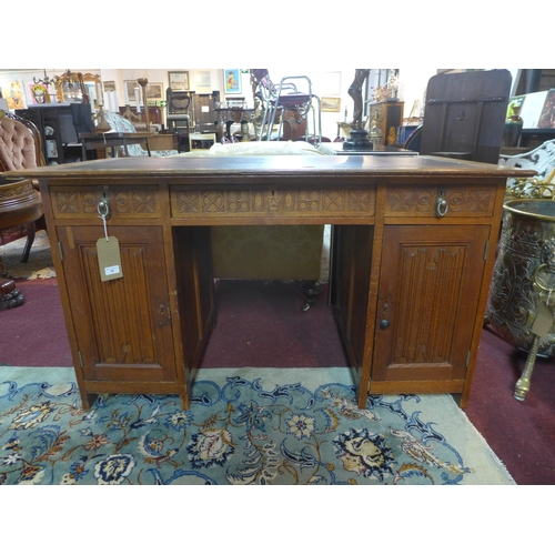 10 - An early 20th century H.Panda & Zonen arts and crafts oak desk, with three drawers and two cupboard ...