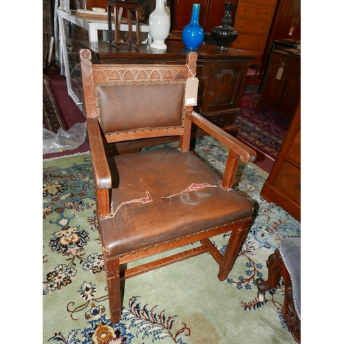 21 - An early 20th century oak Gothic style chair...