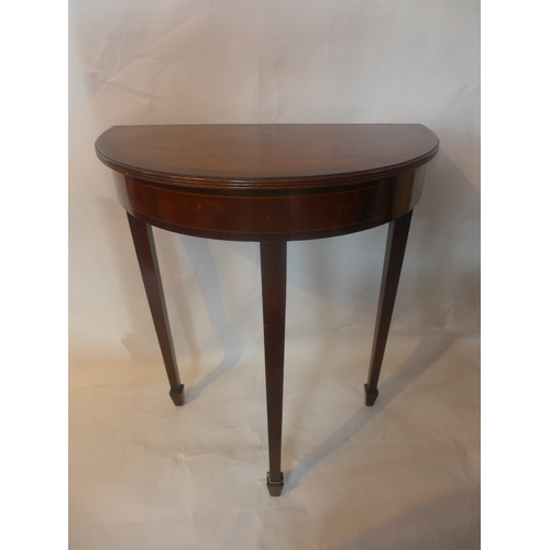 24 - A 20th century inlaid mahogany demi lume console table, raised on tapered legs and spade feet, H.74 ...