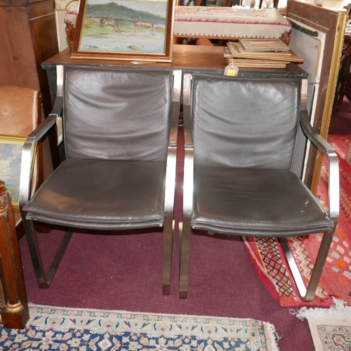 117 - A pair of 20th century cantilever chairs, with brown leather upholstery raised on brushed steel fram...