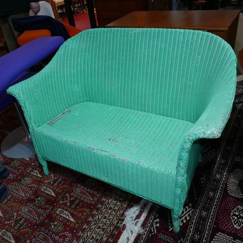 236 - A Lloyd Loom green settee...