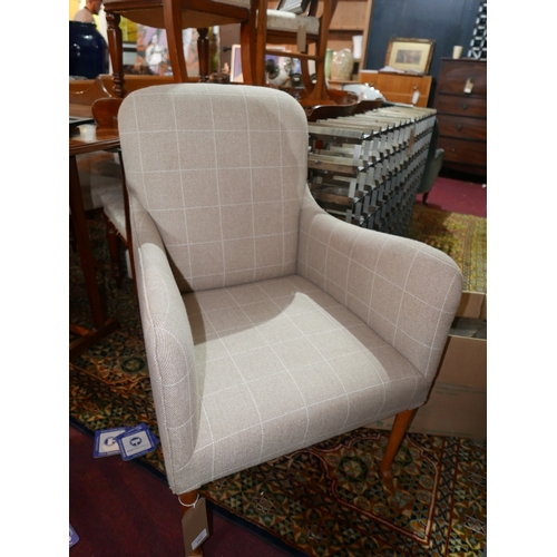 262 - An Edwardian armchair, upholstered in checked oatmeal linen upholstery, raised on slender pad footed...