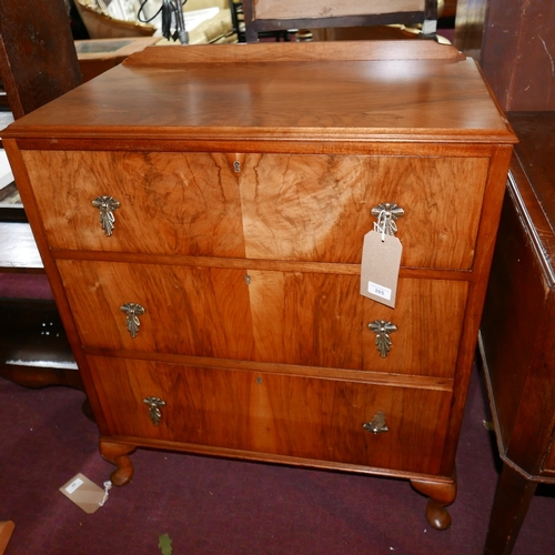 265 - An early 20th century walnut chest of three drawers, H.90 W.75 D.44cm...
