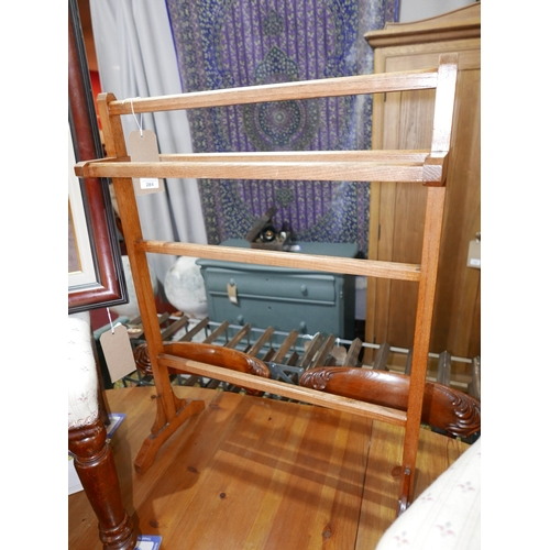 284 - An early 20th century oak towel rail...
