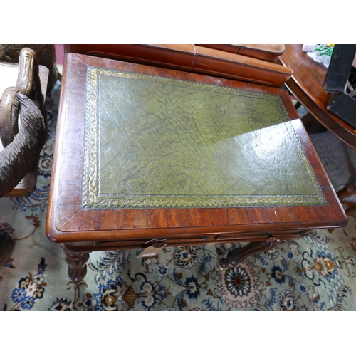 374 - A William IV style mahogany writing table, with green leather top over the drawers, raised on turned...