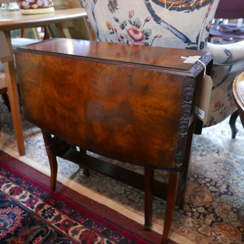 389 - An early 20th century burr walnut sutherland table...