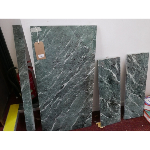 391 - Four slabs of green marble...