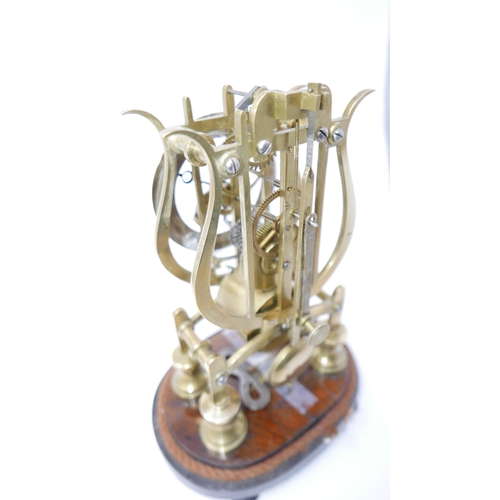 15 - A brass skeleton clock of lyre form, single chain driven fusee movement, brass chapter ring with Rom...