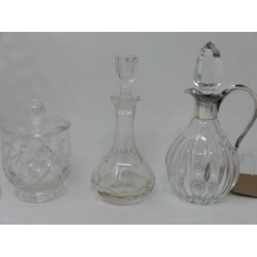 45 - A large signed crystal vase, together with white metal mounted crystal jug, glass scent bottle, Stua...