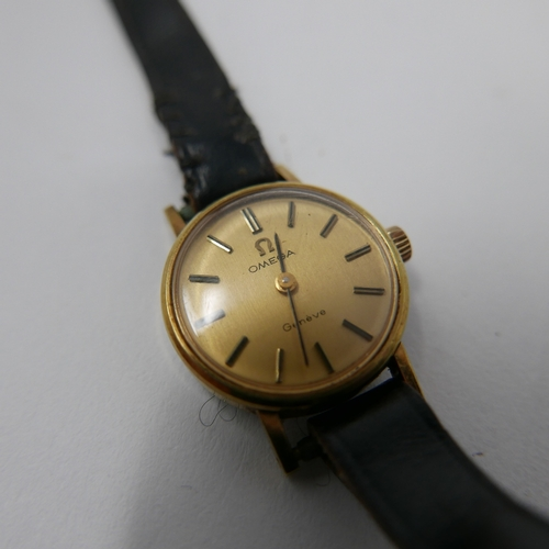 48 - A vintage Omega ladies cocktail watch, gilt dial with baton markers, on associated strap with associ...