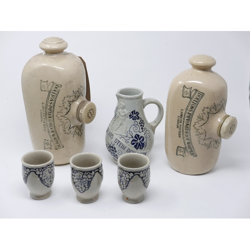 47 - A collection of antique stoneware items, to include two Victorian hot water bottles with black trans...