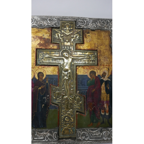 8 - A Russian icon with inset brass crucifix, egg tempera on wood panel with gilded background, with sil...