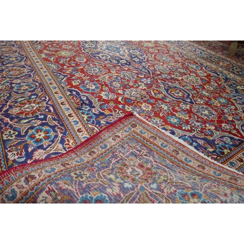 66 - A Persian Kashan carpet, central double pendant medallion with repeating petal motifs and spandrels ...