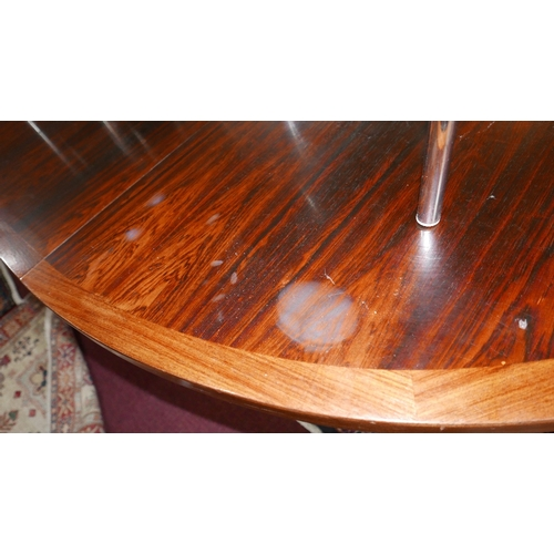 69 - A mid 20th century Danish exotic hardwood dining table, with teak cross banding, stamped 'Heltborg-M...