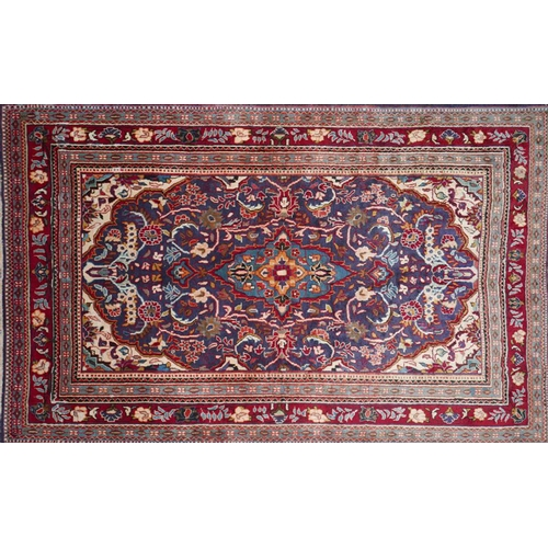 70 - A North West Persian Mahal rug, central double pendant medallion on a sapphire field within stylised...