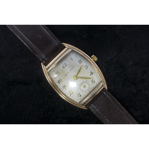 9 - A 1930's gentleman's wristwatch, 14k gold tonneau case with stainless steel back, dial with Arabic n...