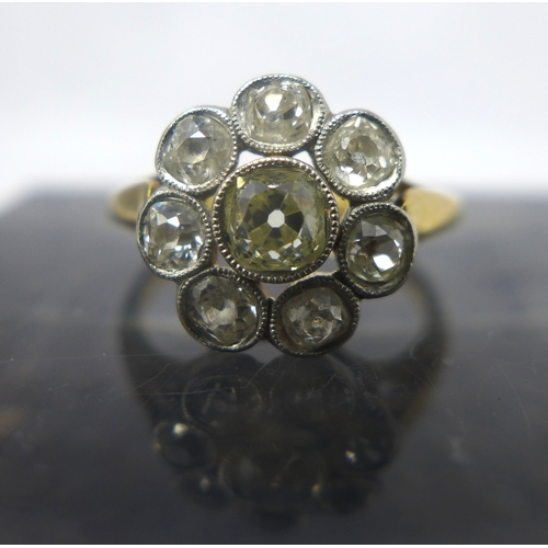 3 - A 1920's 18ct yellow gold old-cut diamond cluster ring, composed of a central diamond surrounded by ...