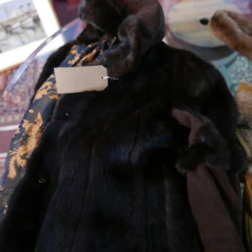 54 - A fur and suede hooded jacket together with a fur vest and two stoles
