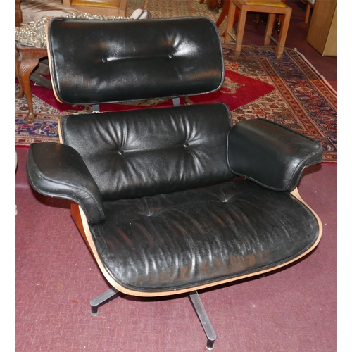 85 - A Charles Eames style swivel lounge chair...